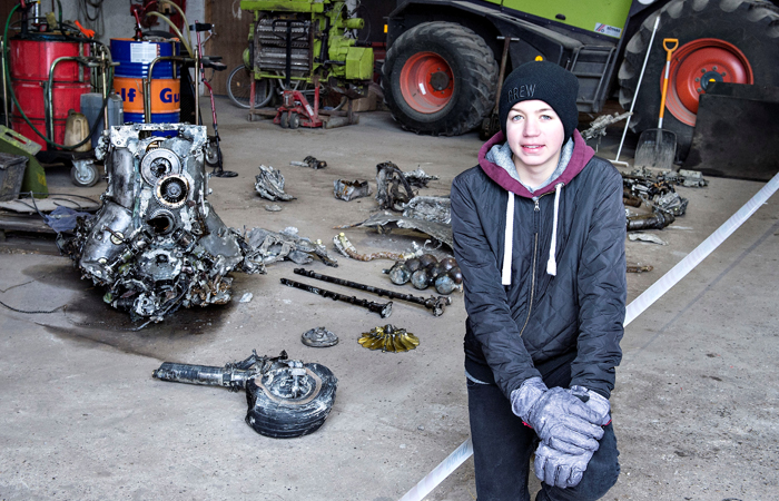 Daniel Kristensen poses with debris from the wreck of a World War II aircraft, which he and his father found yesterday near Birkelse by Aabybro in Northern Jutland, Denmark March 7, 2017. Scanpix Denmark/Henning Bagger via REUTERS    ATTENTION EDITORS - THIS IMAGE WAS PROVIDED BY A THIRD PARTY. FOR EDITORIAL USE ONLY. DENMARK OUT.NO COMMERCIAL OR EDITORIAL SALES IN DENMARK - RTS11S46