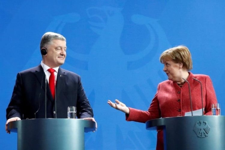 German Chancellor Angela Merkel and Ukrainian President Petro Poroshenko attend a joint news conference after their working lunch in Berlin, Germany April 12, 2019. REUTERS/Fabrizio Bensch